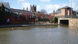 Chester cathedral, the town hall and Cow Lane Bridge with winding hole in the foreground