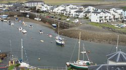 Porthmadog Harbour from above with our Astus 20.2S trimaran bottom right alongside Elizabeth Grace