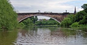 Grosvenor Bridge with St Mary's Church (without the walls) spire on the right.