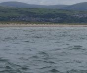 Reading the waves and the colour of the water with Harlech castle in the background.