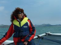 Sue takes the helm as we sail past Harlech