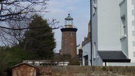 Hoylake Lighthouse nestling among the houses