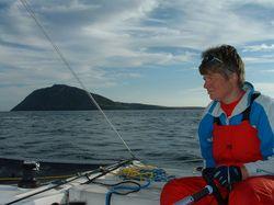 Jackie helming TARDIS past Bardsey Island