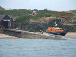 Porth Dinllaen Life Boat being winched back into the Lifeboat Station after coming to our aid.