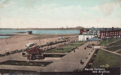 Notice the bathing machines on the beach!