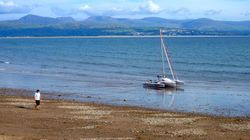 Astus 20.2S in Criccieth bay with Snowdonia and Harlech in the background