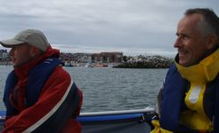 Ray on the left and me on the right with the tiny Rhos-on-Sea harbour in between.