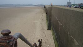 The sea and promenade wall created during the depression