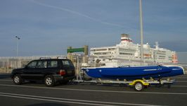 New Blue Magnum 21 trimaran in front of the Brittany Ferries flagship, the Pont Aven