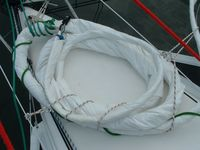Gennaker coiled up on foredeck.