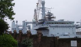 Warship being refitted at Cammel Laird's Shipyard next to the Birkenhead Priory